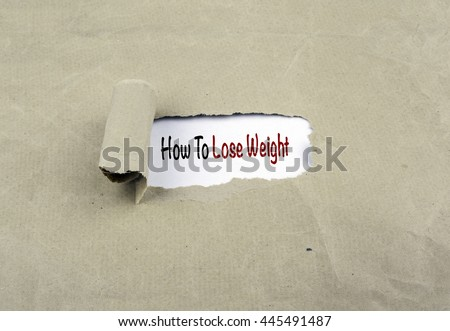 Inscription revealed on old paper - How To Lose Weight - stock photo