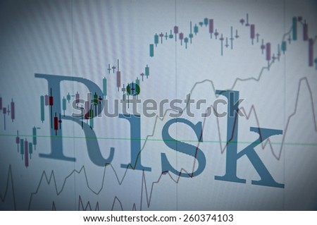"Inscription ""Risk"" on a PC monitor. Financial data as background. - stock photo"