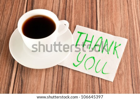 Inscription Thank you on a napkin and cup of coffee - stock photo