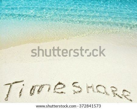 """Inscription """"Timeshare"""" in the sand on a tropical island,  Maldives. - stock photo"""