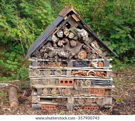 Insect Hotel Made From Materials Collected in a Garden, Devon, England, UK - stock photo