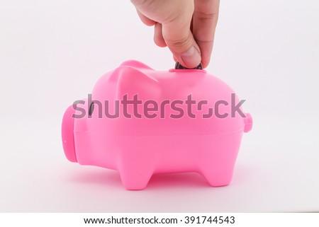 insert Coin of Pink Pig piggy bank - stock photo