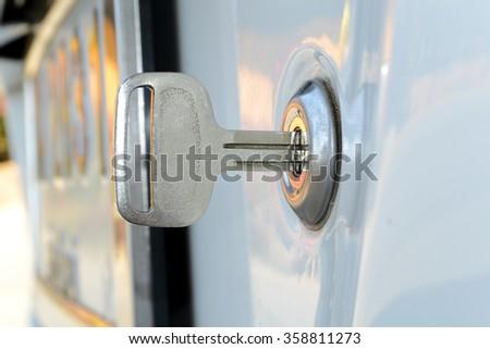 Insert key keyhole door car. - stock photo