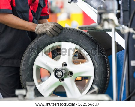 Inside a garage - changing wheels-tires - stock photo