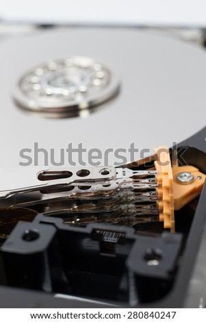 Inside Hard Disk Drive (HDD)-Computer Hardware Components Focus on Actuator Arm. - stock photo
