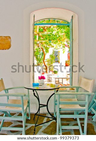 Inside of a beautiful cafe in an old traditional house in Chora the capital of Amorgos island in Greece - stock photo