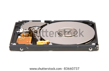 Inside of a SATA hard drive from a laptop - stock photo