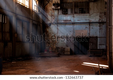 inside of an abandoned factory - stock photo