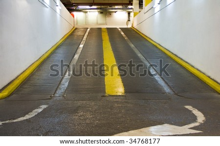 Inside of an indoor parking lot - stock photo