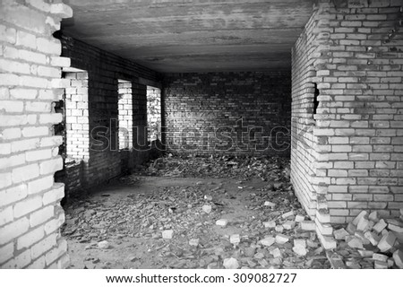 Inside of destroyed house. Ruins. Black and white photo - stock photo