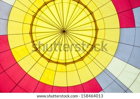 inside of filled colorful hot air balloon - stock photo