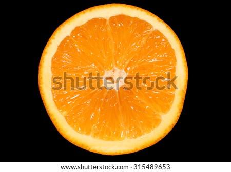 inside of orange on black background - stock photo