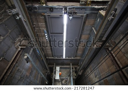 inside of roping Elevator, Lift box built  in high building show strong structure use for engineering construction and industrial object  - stock photo
