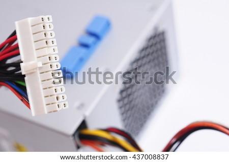 Inside of used power supply unit (PSU) on white background. Computer Power Supply Unit Isolated On White Background, Computer Power Supply Unit Isolated On White Background - stock photo
