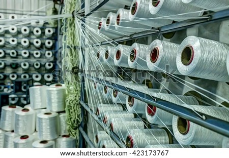 Inside the cotton mill, a factory for producing cotton fabrics, thread, etc - stock photo