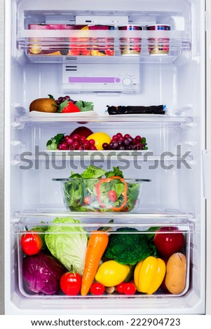 inside the healthy refrigerator with fruits and vegetable - stock photo