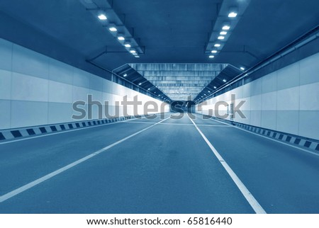 inside the tunnel with motion blur - stock photo