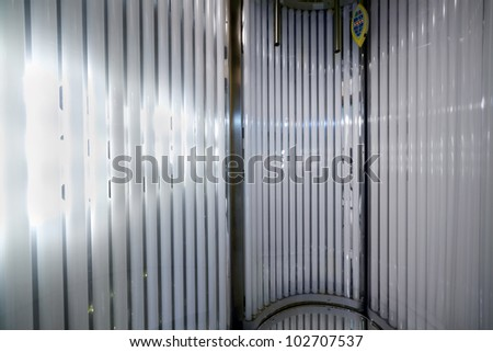 Inside the vertical tanning booth. - stock photo