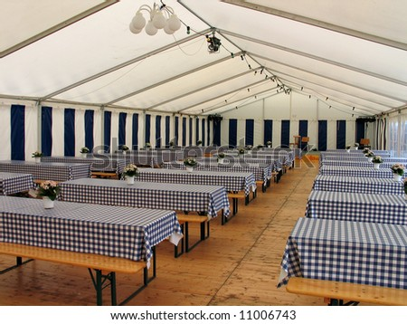 Inside view of a party events wedding celebration banquet tent - stock photo