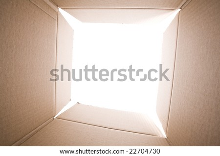 inside view of an empty cardboard box (selective focus) - stock photo