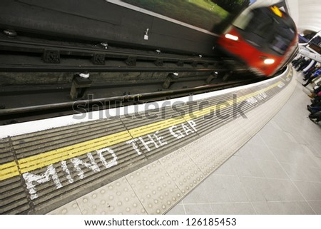 Inside view of London Underground Tube Station with Moving train, motion blurred. - stock photo