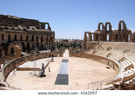 Inside view of the Roman coliseum of Thysdrus at El Jem, Tunisia still in use for classical concerts - stock photo
