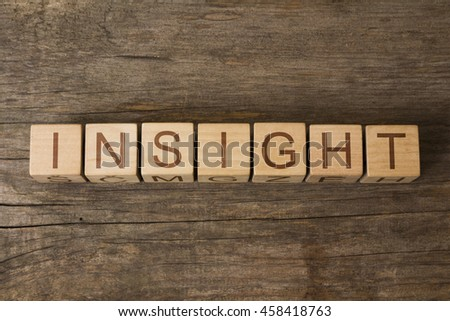 insight text on wooden cubes - stock photo
