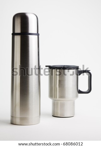 Insolated liquiid container and cup isolated on a white background. - stock photo
