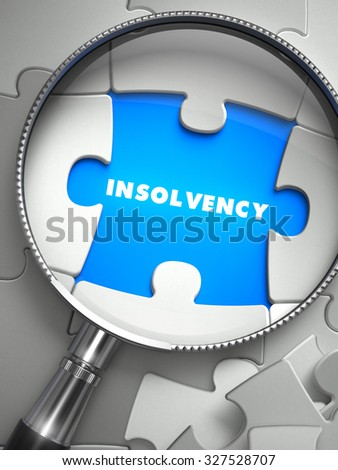 Insolvency - Word on the Place of Missing Puzzle Piece through Magnifier. Selective Focus. - stock photo