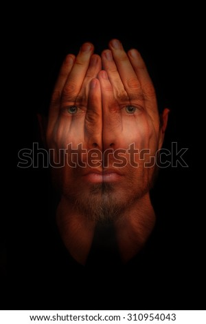 Insomnia conceptual image - sleepless man with hands over open eyes - stock photo
