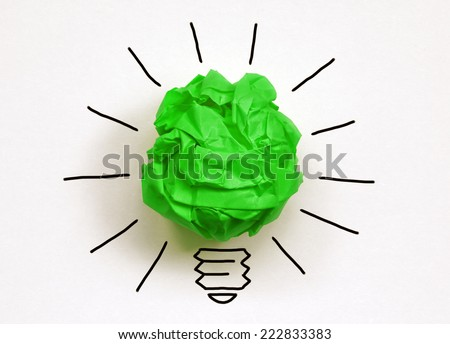 Inspiration environment concept crumpled green paper light bulb metaphor for good idea and environmental conservation - stock photo