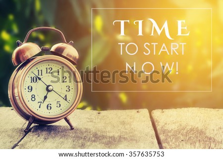 Inspiration Motivational Life Quote on Vintage Nature and Alarm Clock Background - stock photo