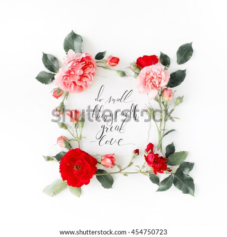 "inspirational quote ""do small things with great love"" written in calligraphy style on paper with pink, red roses, chamomiles and leaves isolated on white background. Flat lay, top view - stock photo"