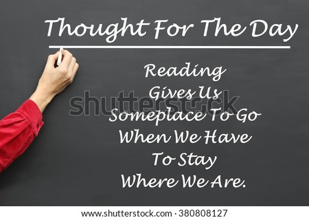 Inspirational Thought For The Day message of Reading Gives Us Someplace To Go When We Have To Stay Where We Are written on a School Blackboard by the teacher. - stock photo