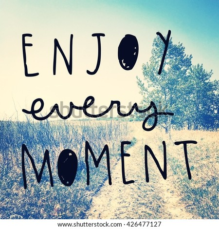 Inspirational Typographic Quote - Enjoy every moment - stock photo