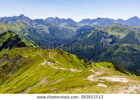 Inspiring Mountains Landscape, sunny day in summer Tatras, mountain ridge over blue sunny sky, Poland in Europe - stock photo