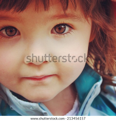 instagram closeup up of little girl with stunning brown eyes - stock photo
