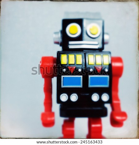 Instagram filtered image of a toy robot - stock photo