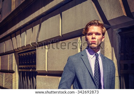 Instagram filtered look and strong harsh sunshine to represent young man attitude - confident, determination, success. American College Student traveling, studying in New York. City Boy.  - stock photo