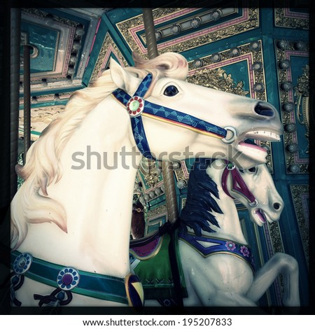 Instagram filtered style image of a carousel horse - stock photo