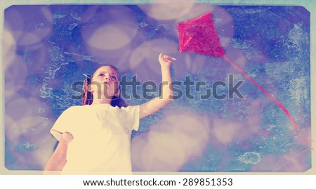 Instagram girl flying a kite in a park with blue sky and texture - stock photo