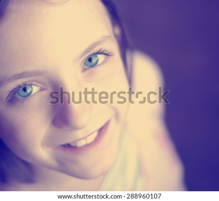 Instagram selfie of young little girl with focus on eyes - stock photo