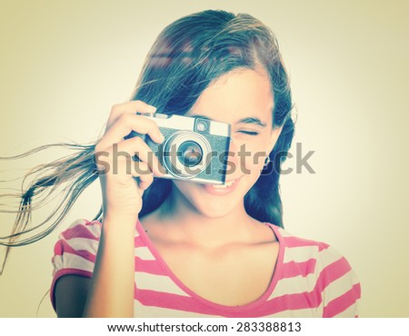 Instagram toned image of a teenage girl using a vintage camera - stock photo