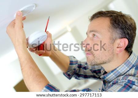 Installation of a smoke alarm - stock photo