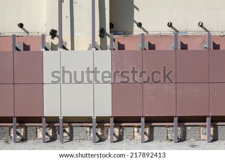 Installation of ventilated facades with tiles of building wall - stock photo