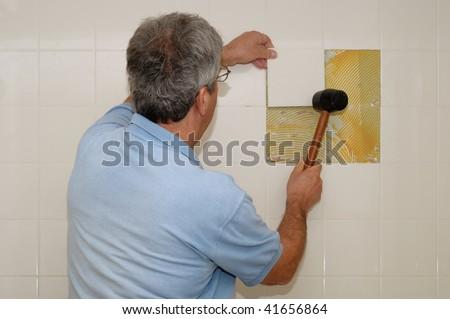 Installing ceramic tiles - stock photo