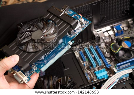 Installing graphical processor unit - stock photo