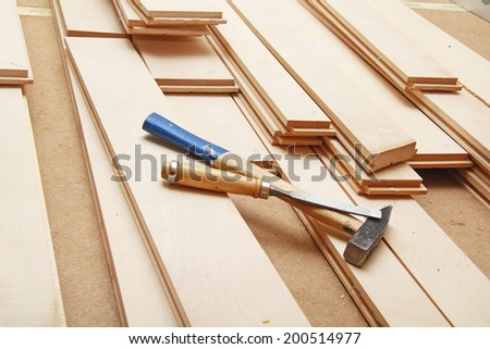 Installing hardwood floor and tools - stock photo