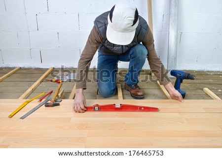 installing laminate flooring in the room - stock photo