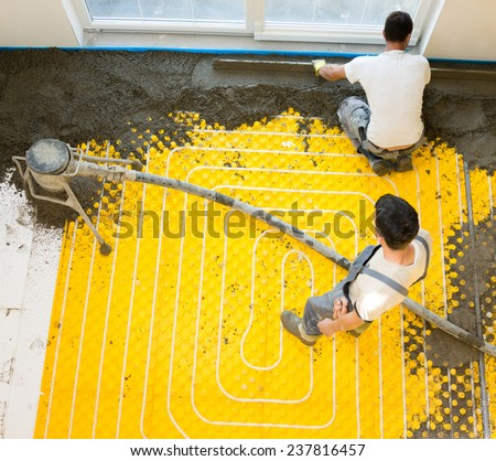 Installing underfloor heating and colling pipes modern system - stock photo